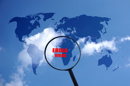 Ebola danger in west Africa, world map and magnifying glass photo