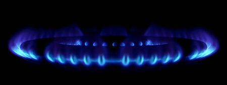gas stove: gas stove burner detail with blue flames and dark background