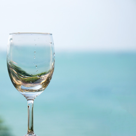 glass wine with sky as background photo