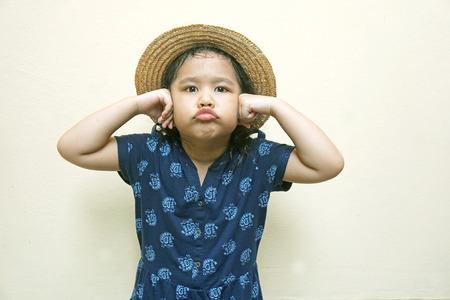 hands over ears: little girl holding her hands over ears