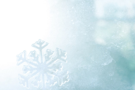 cold weather: ice crystal on snow in blurred background Stock Photo