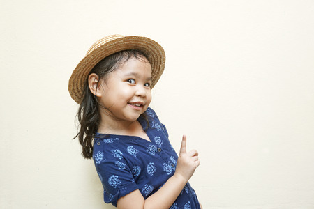 Cute little girl with index finger up photo
