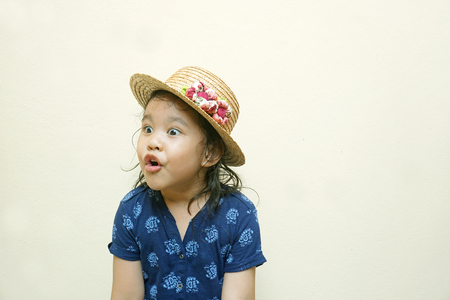 Little girl making funny face photo