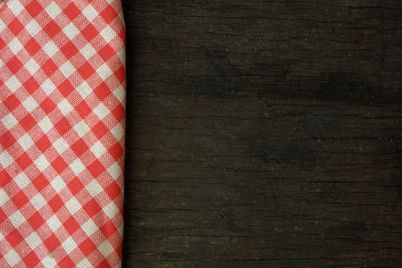 picnic tablecloth: picnic tablecloth on old wooden table top view