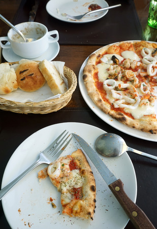 concoct: pizza slices on a plate on table for eat