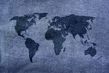 jeans background: world map on denim jeans background