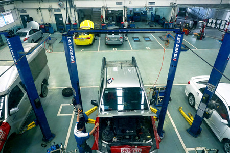 scheduled replacement: BANGKOK - JAN 31: Top view of the workshop service station in Bangkok on January 31, 2015, Thailand. The official dealer of Toyota, who is the top marketshare for commercial car.