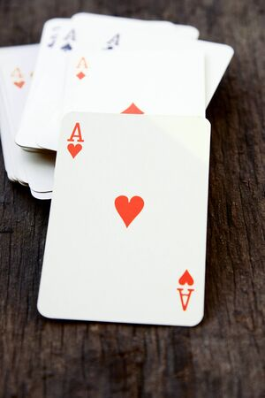 ace: Deck of cards on wooden background (ace of heart)