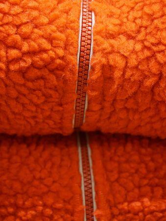 unzipped: zipper on orange wool texture background