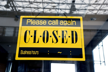 sorry: sorry we are closed sign hanging on a window door outside a restaurant, store