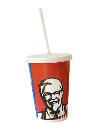 harland: Bangkok, Thailand - March 28, 2015:Paper cups with iced drink KFC logo. KFC U.S. chain of cafes, specializing in chicken dishes.Was founded in 1952, by Harland Sanders Editorial