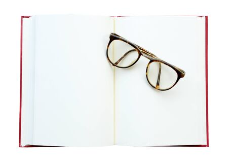 open concept: glasses on the open book. Isolated on white