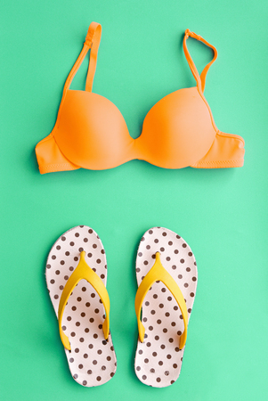 two piece swimsuits: Summer Bikini Concept with Bikini and Flip Flop Sandals Stock Photo