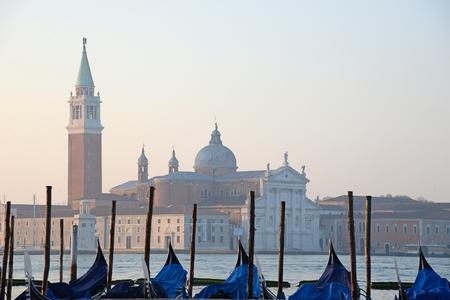 venezia: Gondolas moored by Saint Mark square with San Giorgio di Maggiore church in the background - Venice, Venezia, Italy, Europe