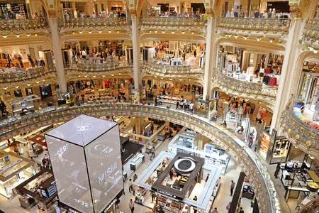 lafayette: PARIS, FRANCE - APRIL 15, 2015: Galeries Lafayette interior in Paris. The architect Georges Chedanne designed the store where a Art Nouveau glass and steel dome was finished in 1912