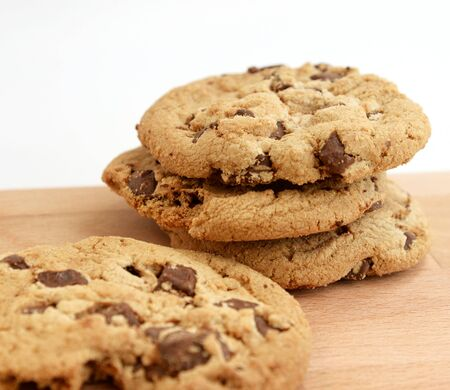 homemade cookies: Stack of Chocolate chip cookies on wooden background Stock Photo