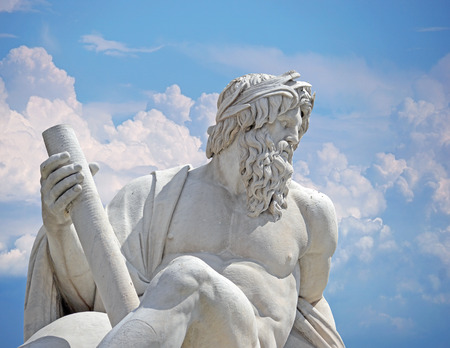 Zeus against blue sky, detail of Italy Rome Navona square four rivers fountain Rome