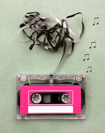blow out: Vintage looking Magnetic tape cassette for audio music recording with song note blow out