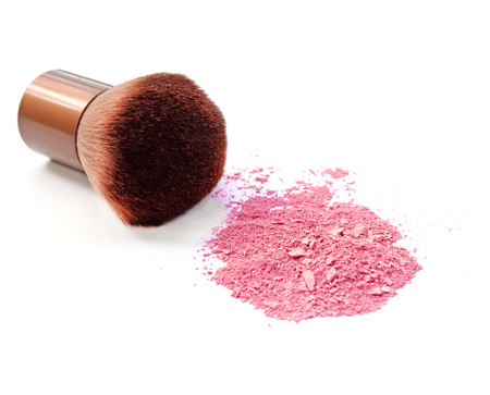 Cosmetic powder brush and crushed blush palette isolated on white photo