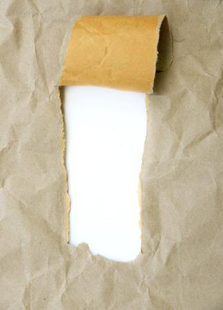 Torn brown paper Standard-Bild