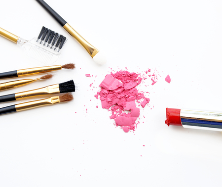 pink powder: set of make up cosmetic, brush, pink powder, lipstick on white background Stock Photo