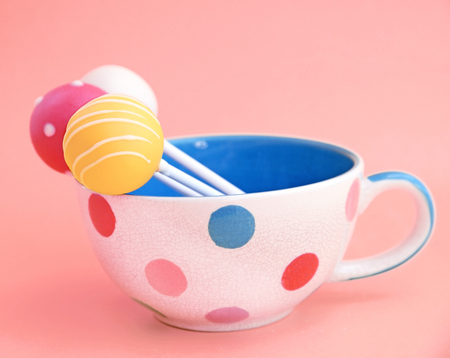 christmas memories: Cake pops decorated in cup on pink background