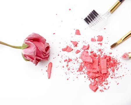 pink powder: cosmetic brushes, pink powder and rose on white background Stock Photo