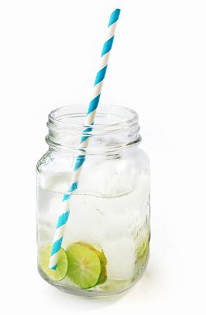Lemonade ice, lemon slices in a jar with straw