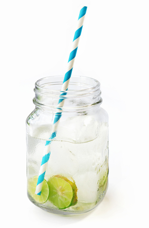Lemonade ice, lemon slices in a jar with straw