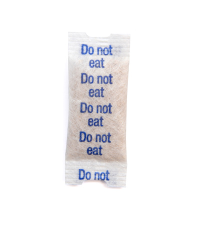 silica: Paper packet of silica gel isolated on white