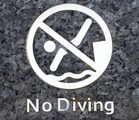 no swimming sign: no diving warning at swimming pool