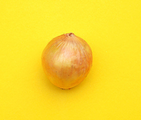 yellow art: Ripe onion on yellow background (Pop art style) Stock Photo