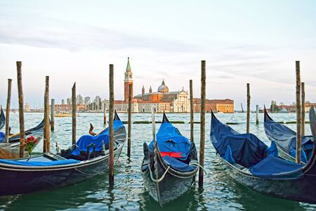 sea world: Gondolas moored by Saint Mark square with San Giorgio di Maggiore church in the background - Venice, Venezia, Italy, Europe