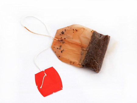 Used Tea Bag on White Background Archivio Fotografico