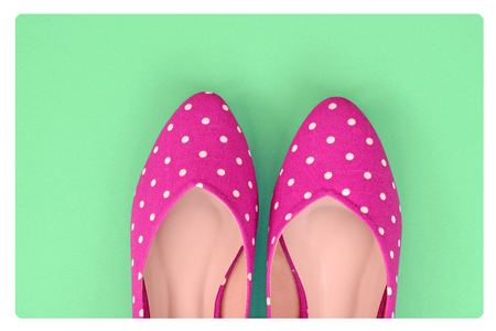bright color: Vintage polka dot shoes on green background Stock Photo
