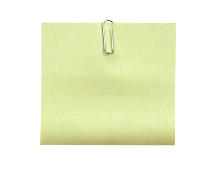 Note with a paper clip. Isolated on a white background (clipping path)