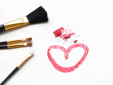 pink powder: Cosmetic brush and pink powder on white background