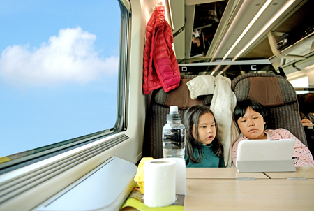 openly: Two little girls ride on the train Stock Photo