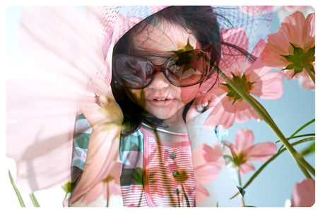little girl: Double exposure portrait of little cute girl with flower background Stock Photo