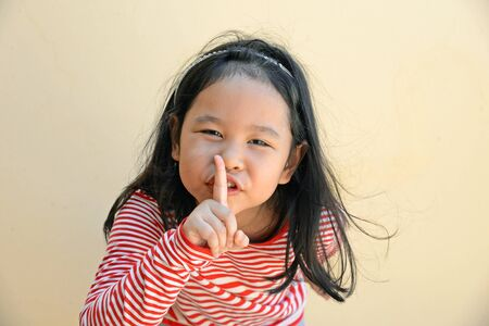 hushed: little girl say silence is a secret