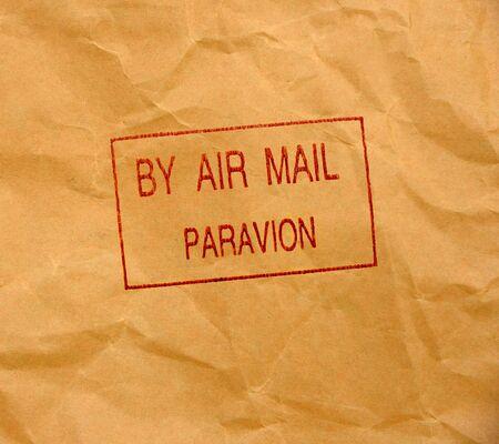 par avion grunge stamp on crumpled paper background