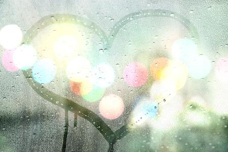 Autumn rain, draw heart on glass - love concept Standard-Bild