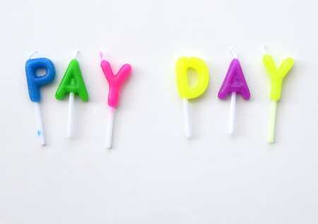 payday: Candle made of word Pay Day. (financial concept) Stock Photo