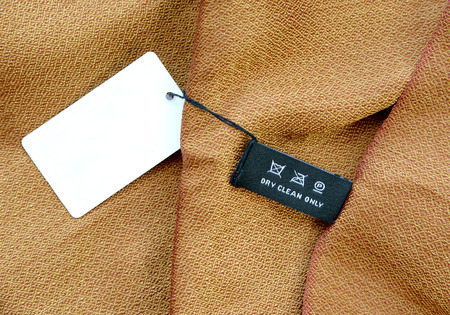 fabric label: symbols set on clothing label on silk fabric Stock Photo