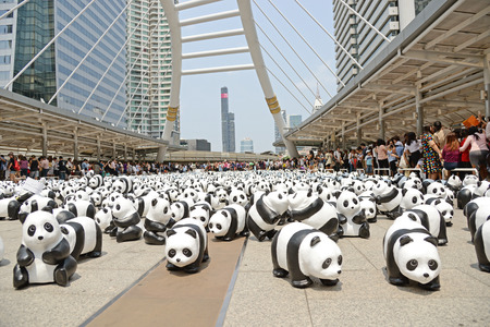 wwf: Bangkok, Thailand - March 8, 2016 : 1600 Pandas World Tour in Thailand by WWF at BTS Skywalk. 1600 paper marche pandas are made from recycled materials to represent 1600 pandas left in the wild.