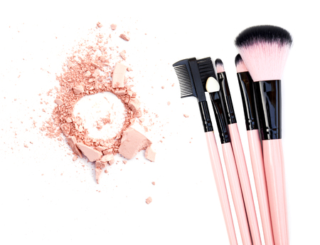 beautify: cosmetic brush and powder isolated on white