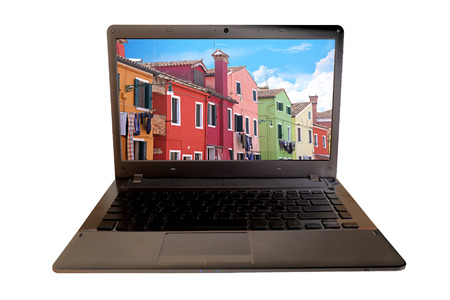 burano: Laptop with landscape of colorful city Burano island on screen isolate. Italy Stock Photo