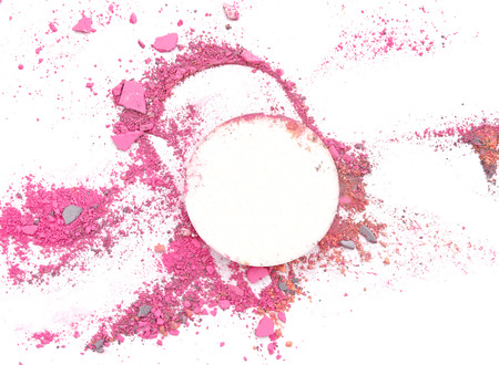 strewed: makeup sponge and broken multicolor eyeshadow