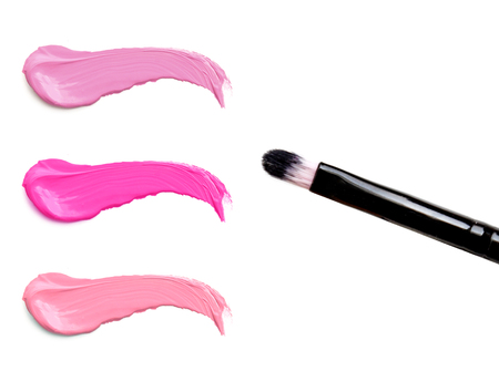 lip stick: lipstick stroke (sample) with makeup brush, isolated on white