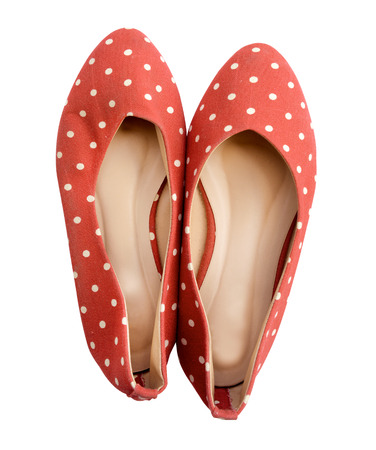 polka dotted: pair of stylish flat shoes, with polka dotted pattern, isolated on white background. (clipping path)